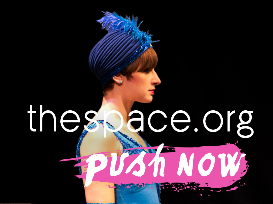 A performer in a blue leotard and feathered turban against a black background - text reads push now, the space.org