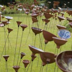 A field of ceramic flowers