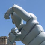 the head and arms of the inflatable against a blue sky