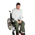 a photo of laurence clark in his wheelchair.
