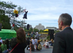 The back of Charles watching The Garden - a show with artists on sway poles on the terrace outside the south bank centre